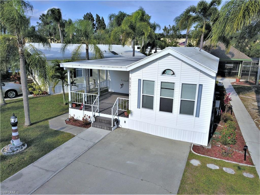 SW Florida Real Estate - View SW FL MLS #219026600 at 10715 Red Cardinal Cir in  in ESTERO, FL - 33928
