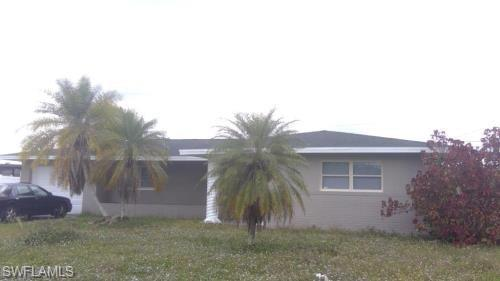 SW Florida Real Estate - View SW FL MLS #219024397 at 405 E Jasmine Rd in LEHIGH ACRES in LEHIGH ACRES, FL - 33936