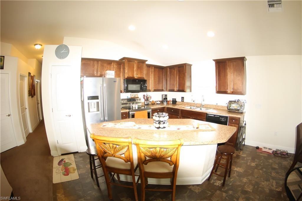 CAPE CORAL Real Estate - View SW FL MLS #219050859 at 537 Tropicana Pkwy E in CAPE CORAL at