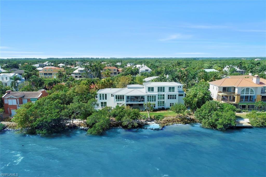 SANIBEL ISLES Home for Sale - View SW FL MLS #219040027 at 1540 San Carlos Bay Dr in  in SANIBEL, FL - 33957