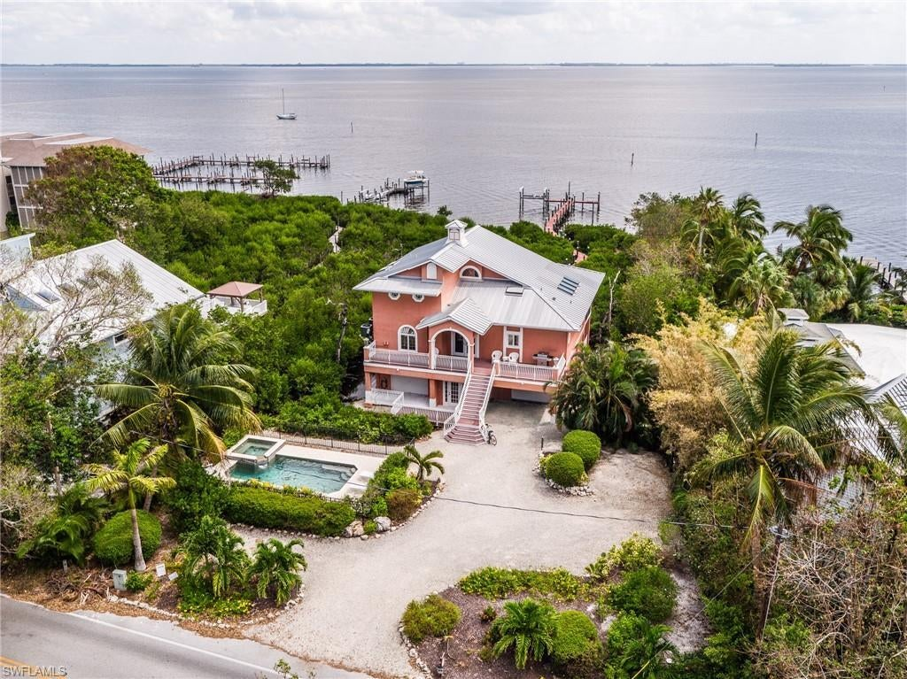 SW Florida Home for Sale - View SW FL MLS Listing #219067940 at 15133 Captiva Dr in CAPTIVA, FL - 33924