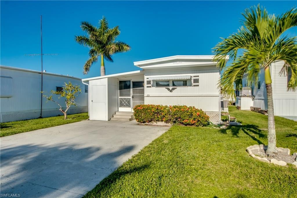 PORT CARLOS COVE CO-OP INC Real Estate - View SW FL MLS #219068374 at 25 Doubloon Way in PORT CARLOS COVE CO-OP INC in FORT MYERS BEACH, FL - 33931