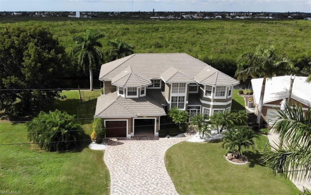 SW Florida Real Estate - View SW FL MLS #219074572 at 3306 Tripoli Blvd in BURNT STORE ISLES in PUNTA GORDA, FL - 33950