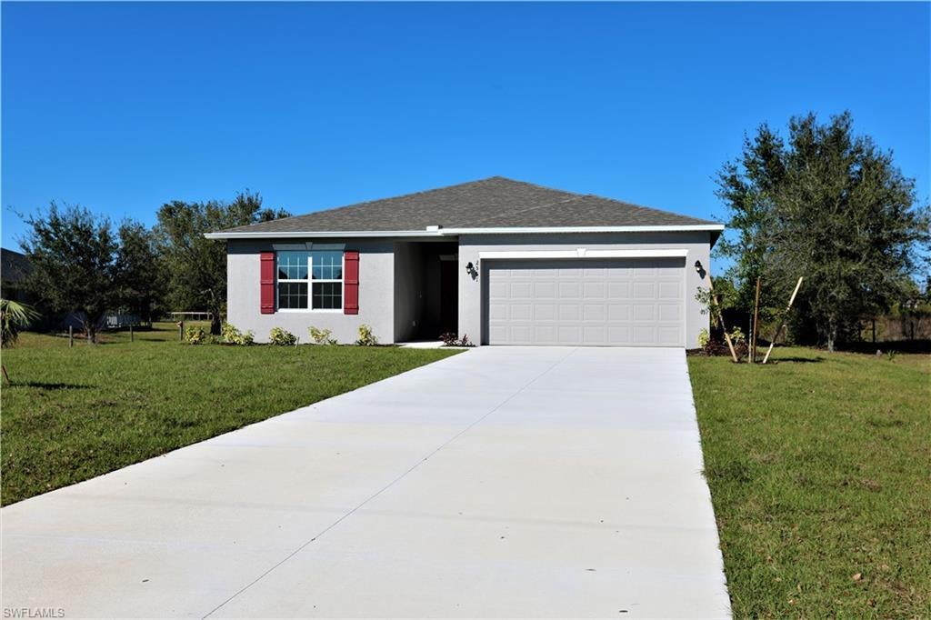 SW Florida Real Estate - View SW FL MLS #220009119 at 2561  39th Ave Ne in GOLDEN GATE ESTATES in NAPLES, FL - 34120