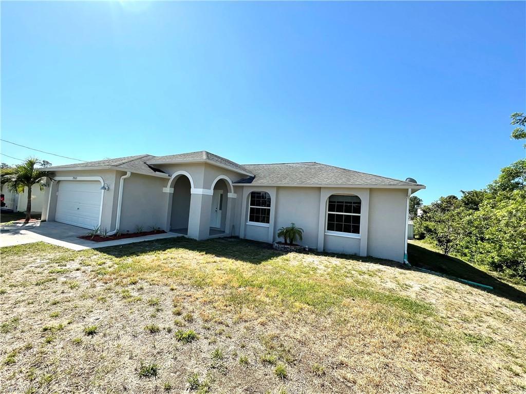SW Florida Real Estate - View SW FL MLS #221025357 at 2903 21st St W in LEHIGH ESTATES in LEHIGH ACRES, FL - 33971