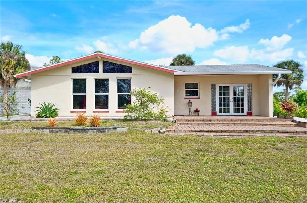 SW Florida Real Estate - View SW FL MLS #221058276 at 6751 School Ln Ne in BUCKINGHAM AIR PARK EAST in FORT MYERS, FL - 33905