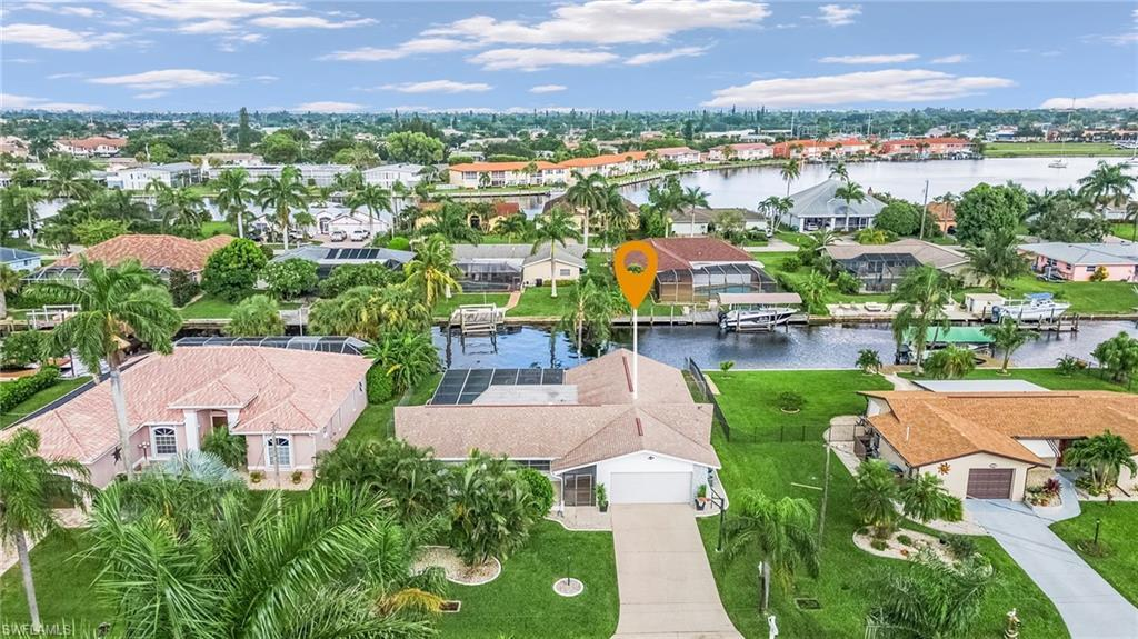 CAPE CORAL Real Estate - View SW FL MLS #221064945 at 419 Pinecrest Ct in CAPE CORAL in CAPE CORAL, FL - 33904